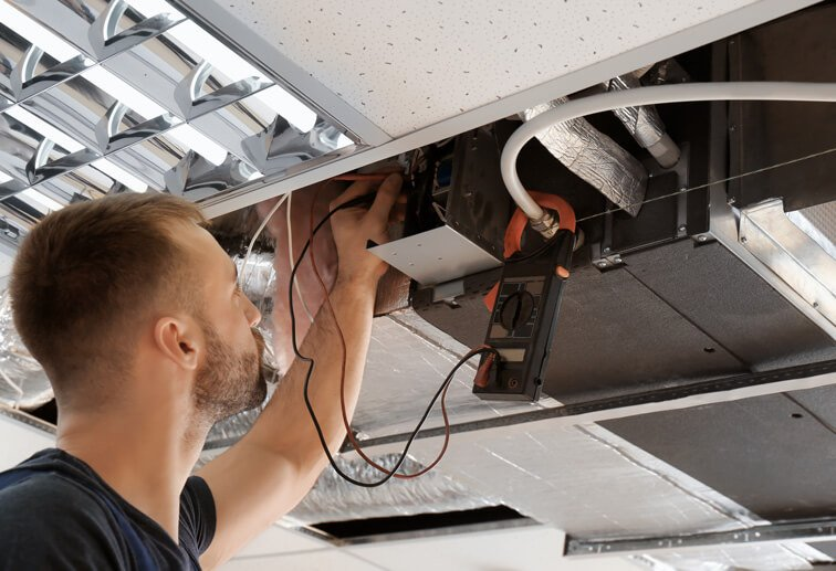 Electrical Service Software - Technician Working on Air Conditioning