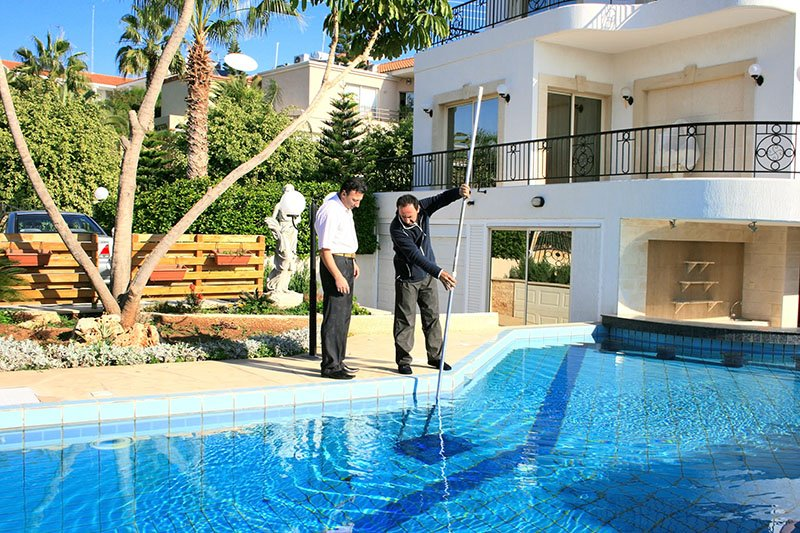pool-service-tech-with-property-owner